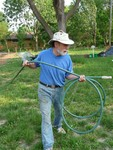Volunteer with Donated Hose
